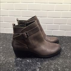 Vince Camuto VP Beamer Booties Love these boots! Leather with inside zipper, and a cute wrap buckle accent. Pretty light brown/almost grey in color. Vince Camuto Shoes Ankle Boots & Booties