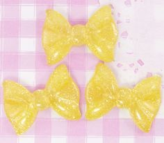 Extra cute large yellow glitter ribbon bows. These flat back resin cabochon beads are perfect for all kinds of kawaii crafts, including decoden, jewellery making, card making, scrapbooking and more!!