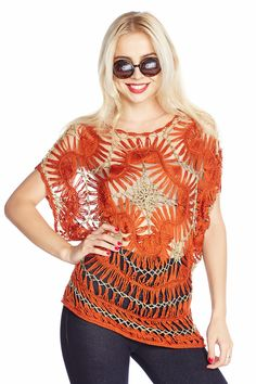 Interesting way hairpin lace is used as the center medallion in this sweater idea.