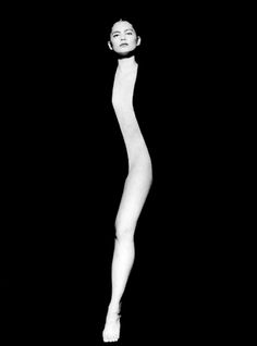 """""""Sense"""", of a woman encased in black fabric with the exception of her face and a thin line of her naked body launched Tono Stano's career as a photographer"""