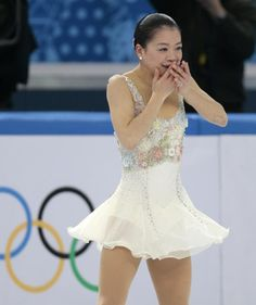 Akiko Suzuki of Japan reacts after completing her routine in the women's free skate figure skating finals at the Iceberg Skating Palace during the 2014 Winter Olympics, Thursday, Feb. 20, 2014, in Sochi, Russia. (AP Photo/Ivan Sekretarev)