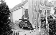A German StuG III rolls past a British parachute, belonging to a supply container, in Oosterbeek. #WW2