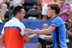 Pablo Carreno Busta, right, of Spain, shakes hands with Roberto Bautista Agut, left, also of Spain, after winning the championship match of the Winston-Salem Open tennis tournament in Winston-Salem, N.C., Saturday, Aug. 27, 2016. (AP Photo/Chuck Burton