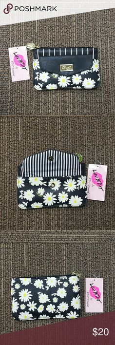 Betsey Johnson Pouch Packet Wristlet Beautiful white flowers surrounded in black. It has gold hardware a top zip with a exterior button snap closure. It has a black and white striped design interior with pink lips and Luv Betsey writing. Bags Clutches & Wristlets