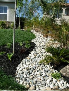 dry riverbed landscape photos | Add a dry river bed to your landscaping