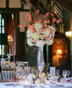Tall table centre in peaches and pinks, Ramster Hall, Chiddingfold