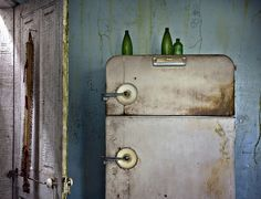 Abandoned farmhouse in rural Indiana.  The house was left with so much intact, it looked like a movie set.    bottles on the fridge by jody9, via Flickr
