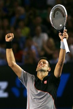 Novak Djokovic of Serbia celebrates winning his first round match against Lukas Lacko of Slovakia during day one of the 2014 Australian Open...