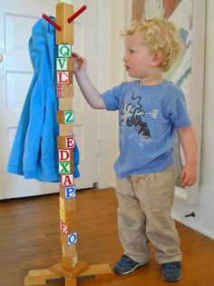 Use classic wooden letter blocks to create a kids' coat rack. To keep this project on budget, we recycled an old floor lamp to use as the base.