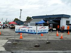 Banners at a free Fall Car Care Month vehicle check-up in Octover