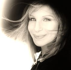 Barbra Striesand, don't like her politics but like her voice.