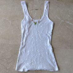 Express white sequin tank top Super cute white sequin tank top by Express in size XS.  Can be worn for all occasions to match with anything.  There are no stains and no tears in the sequins. It has a nice stretch so it fits comfortably. I normally wear a S but XS is perfect! Express Tops Tank Tops