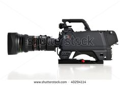 Professional video camera facing left isolated on a white background