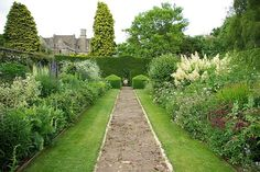 Herbaceous borders at Rodmarton Manor, Gloucestershire, UK. Another notable Arts and Crafts garden. Building, decorating, and garden design began as a unified project in 1909 and continued for 20 years.