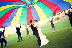 love this wedding photo. would be so fun to whip that up and run underneath to get the picture quickly!