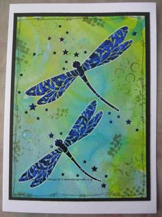 Sweet Poppy Stencils - Fairy Dragonflies in black onto a Cosmic Shimmer Ink Mister Background.  www.aldridgecrafts.co.uk
