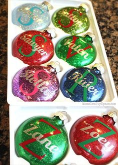 DIY Personalized Glitter Christmas Ornaments - step-by-step tutorial for creating these glitter ornaments plus how she added the lettering and even what fonts she used (in the comments)! Glitter Ornaments, Diy Christmas Ornaments, Christmas Projects, Holiday Crafts, Holiday Fun, Christmas Decorations, Ornaments Ideas, Glitter Decorations, Homemade Christmas Ornaments