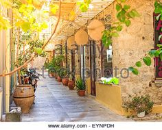 Download this stock image: Beautiful traditional old style street in Nafplion, Greece - EYNPDH from Alamy's library of millions of high resolution stock photos, Stock Photo, illustrations and vectors.