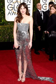 Dakota Johnson Dakota Johnson put her own spin on head-to-toe shine — a look you've seen before at many a Hollywood awards ceremony — and picked a Chanel Couture dress that looked like the Fifty Shades of Grey actress was dripping with diamonds as she strutted down the red carpet. It was magical, and we couldn't look away.