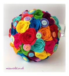 I absolutely adore this rainbow bouquet and love making it too :) Alternative wedding bouquet of felt roses with button detail. Miss Violet Wedding Flowers Wedding Flowers Norwich, Norfolk UK Rainbow Bouquet, Felt Flower Bouquet, Felt Roses, Felt Flowers, Red Christmas, Christmas Wedding, Wedding Bouquets, Wedding Flowers, Wedding Stuff