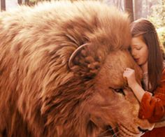 """""""But courage, child: we are all between the paws of the true Aslan.""""  ― C.S. Lewis, The Last Battle"""