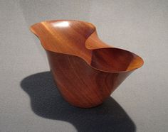 Beautiful hand carved one-of-a-kind African mahogany bowl.