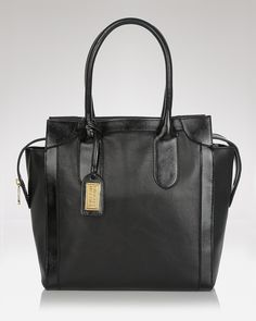 Badgley Mischka Tote - Rhonda Nappa  465.00. I really think this one might be #theOne. It looks enough like the Celine luggage tote to partially satisfy my desire while still staying within my price range.