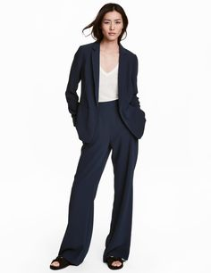 Check this out! High-waisted suit pants in woven fabric with a tab and button at sides. Side pockets, mock back pockets, side zip, and wide, straight legs. - Visit hm.com to see more.