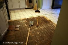 Removing vinyl/luan flooring. This may come in handy when we redo the kitchen!