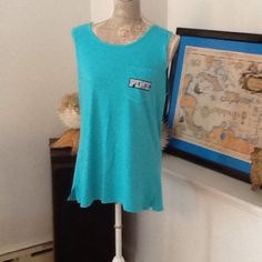 BNWT VS PINK CAMPUS TANK TOP W/POCKET $25 BNWT VS PINK CAMPUS TANK TOP W/POCKET oversized tank top turquoise color with PINK written on the back and pocket in black/white NO TRADES NO OTHER APPS will will price drop PINK Victoria's Secret Tops Tank Tops