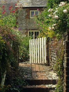 The gate, inviting you in.  The eclectic paving, the smell of the roses, you can only imagine the beauty beyond.