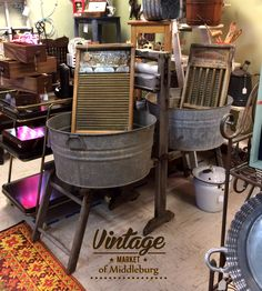 Vintage wash tubs and stand with wringer hand crank. Also the scrubbing boards <3.