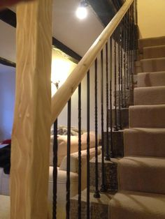 We replaced the pine spindles and handrail and installed cask iron spinels and distressed the newel post