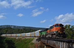 https://flic.kr/p/R1ksK3 | BNSF C44-9W 977-270 | NS Eastbound Vehicle Train 270 ( Birmingham to Lincoln, AL Honda Plant ) passes through Cook Springs, AL with BNSF H-1 C44-9W 977 leading a BN SD60M with Bald Rock Mountain as the background, one of my favorite spots on the NS Birmingham East End District