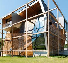 heri&salli inscribes angular volume inside timber frame for office off