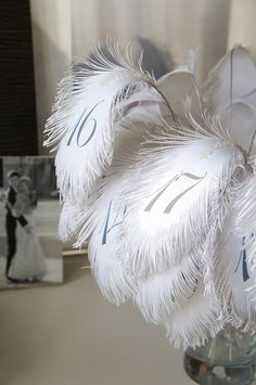 Check out the amazing feather wedding table numbers featured on www.bitzybride.com! Get the Ostrich Plumes needed to recreate this look here: http://www.craftsfeathersfloral.com/home/cff/page_7180_1244/ostrich_plume_13_15_off_white.html