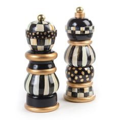 "MacKenzie-Childs - Courtly Check Salt & Pepper Mill Set - 7"" We've taken traditional salt and pepper grinders and turned them into statuesque tabletop conversation pieces by adding our signature checks. But the 7"" Courtly Check Salt & Pepper Mill Set is more than just pretty: The ceramic-geared grinders have excellent mechanics and are built to last, for use with whole peppercorns and coarse salt. Hand painted. Makes for a fantastic gift!"