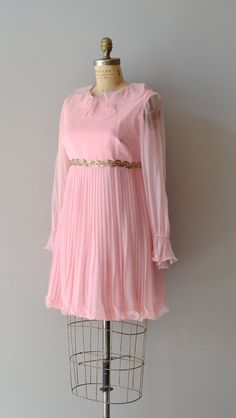 chiffon 1960s dress. I wore one like this to. My brothers wedding.  How funny