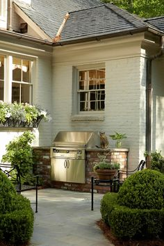 like this better than a total built in out door kitchen that will need to be redone in 6 years.Outdoor grill surrounded by stone. Love this outdoorspace, as well as the painted brick exterior! Outdoor Rooms, Outdoor Living, Outdoor Decor, Outdoor Kitchens, Outdoor Bars, Outdoor Showers, Outdoor Patios, Outdoor Plants, Porches