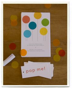 Balloon party invitations (rolled up and put inside of an inflated balloon) with the 'pop me' instructions tied to the ribbon