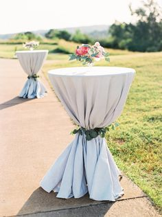 Cocktail Hour French Blue Striped Cocktail Tables tied with Eucalyptus Leaves   Blush and Navy Wedding with Fuchsia, French Blue and Gold Accents   Simply Jessica Marie's Southern Wedding at Gettysvue Golf Course and Country Club in Knoxville Tennessee   Photo by Perry Vaile Photography