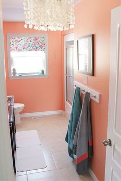 Open your doors and let those spring colors in! A perfect shade of peach painted on these bathroom walls. Paint color is Coral Serenade (129-5) from PPG Voice of Color Paint. :: Devine Paint Center Blog