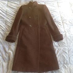 Zara Woman Long Brown Wool Angora Coat Lovely coat by Zara, a brownish color (best pic of color in close-up snapshot of pocket). Blended fabric. Structured and tailored fit. Cuffed sleeves, you can extend/un-cuff for extra long sleeves. Double breasted. Super warm! Excellent condition save for a rip in the inside pocket lining, I forget if it's the right or left pocket. Easy fix. Size S, best for size 2. Zara Jackets & Coats Pea Coats