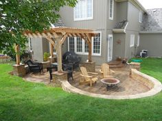 beautiful-outdoor-living-areas-blend-into-one-multi-use-hardscape-patio-retaining-wall-pergola-with-flagstone-patio-also-backyard-landscaping-idea-backyard-patio.jpg (1280×960)
