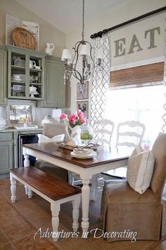 A Charming Farmhouse Table via Adventures in Decorating Use a farmhouse table (or DIY the farmhouse table look), vintage antiques, and country pastel colors (sage, cream, pale blue) to capture the essence of country decorating. A little warm colored wood in the kitchen will also help give off the country farm vibe. via Hometalk