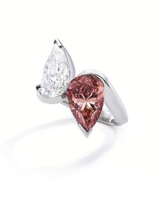 "Platinum, Fancy Vivid Orangy Pink Diamond and Diamond ""Toi et Moi"" Ring, Olivier Reza Set with a spectacular pear-shaped Fancy Vivid Orangy..."