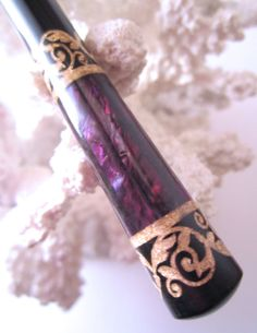 "The ""Princess Eve"" Hair Stick Featuring Gabon Ebony Inlaid with Gold Leaf and Purple Paua Shells"
