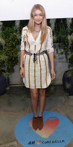 #GIGIHADID Hadid got stripes right at the H&M Loves #Coachella party in a lined LWD, accenting it with turquoise accessories and suede booties.