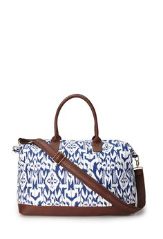 Blue paisley designed bag with leather detailing along the bottom and on the straps. (cross body bag and an over the shoulder)