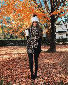 What's not to love about this outfit?  Love the scarf and hat, against the monochromatic sweater and leggings!